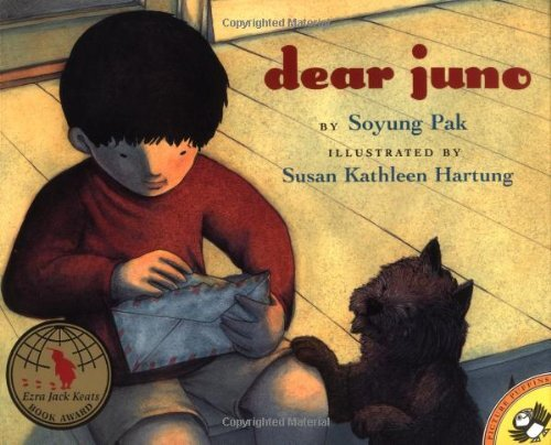 "Book cover of ""Dear Juno"" written by Soyung Pak and illustrated by Susan Kathleen Hartung featuring an illustration of a boy with a letter and a dog next to him."