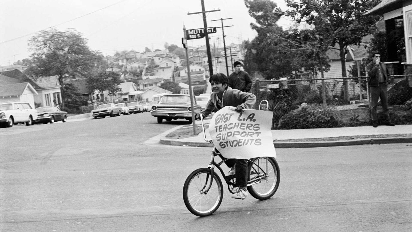 Boy on a bicycle | Debra Weber, Courtesy of UCLA Chicano Studies Research Center La Raza AB s9