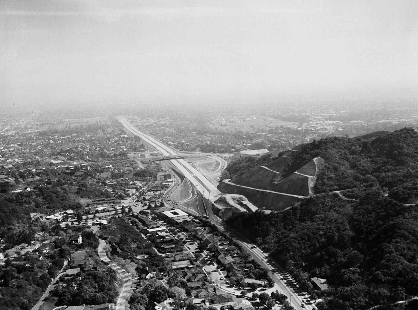 1957 aerial view of the San Diego (I-405) Freeway under construction through Sepulveda Canyon, courtesy of the Los Angeles Examiner Collection, USC Libraries.