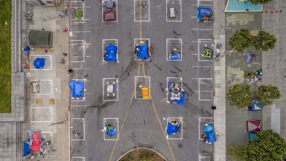An encampment of homeless at a parking lot | iStock