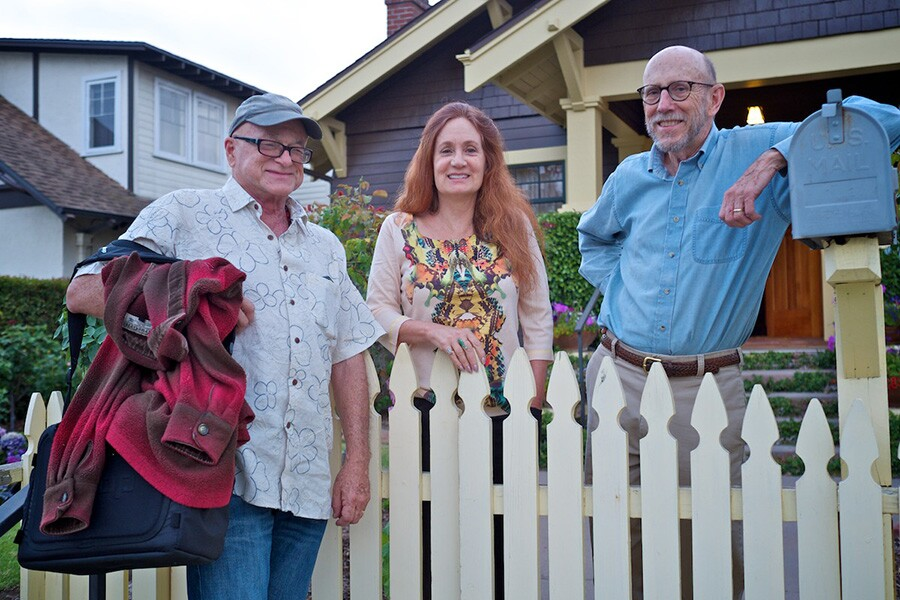 Writer Christopher Langley, painter Patricia Chidlaw, and her husband Bob Sponsel in front of Chidlaw's craftsman house in Santa Barbara. | Photo: Osceola Refetoff.