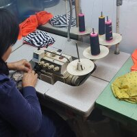 Uncle Van Huynh's mother sews masks for the Auntie Sewing Squad. | Courtesy of Van Huynh