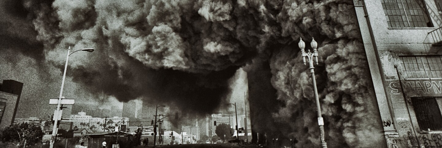 A large building housing a swap meet mall on fire at 7th Street and Union Ave in Pico/Union. LA Riots | Ted Soqui