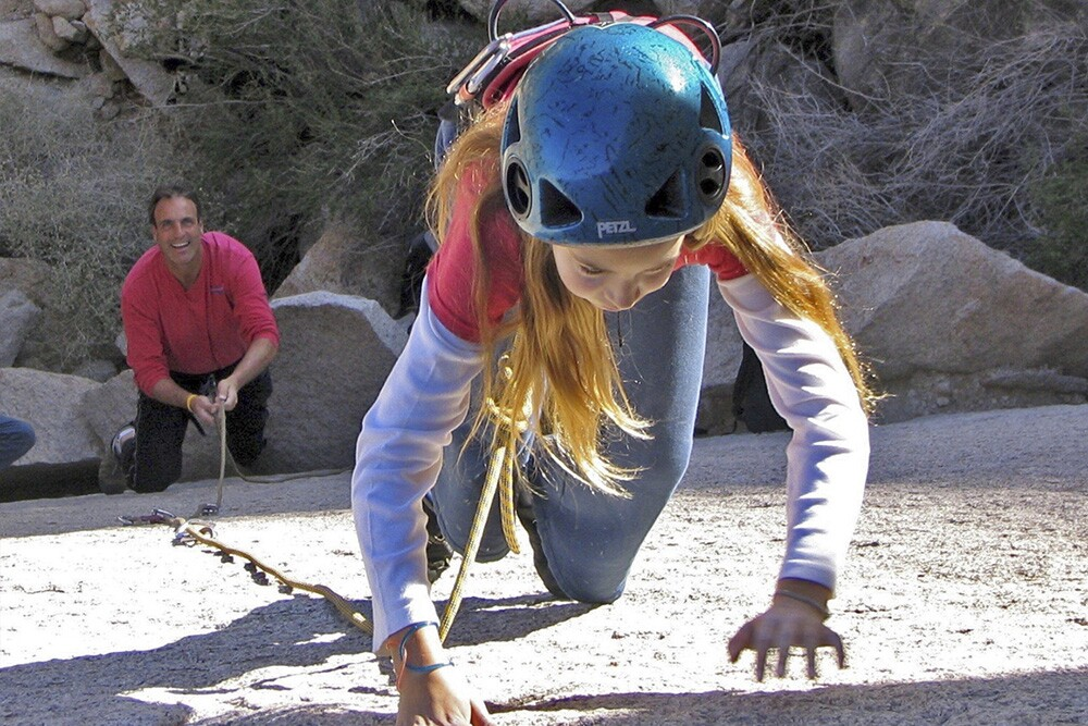 A young Sierra Zacks on lead belayed by her father Dan Zacks at JTNP. | Locker Thompson | Courtesy of the Zacks family.