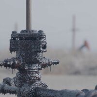 "Closeup shot of residue on oil pump jack. | Still from ""Earth Focus"""