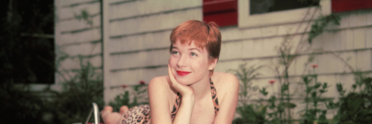 """Shirley MacLaine, actress of Paramount Pictures, soon to be seen in the movie The Trouble With Harry."" (primary)"