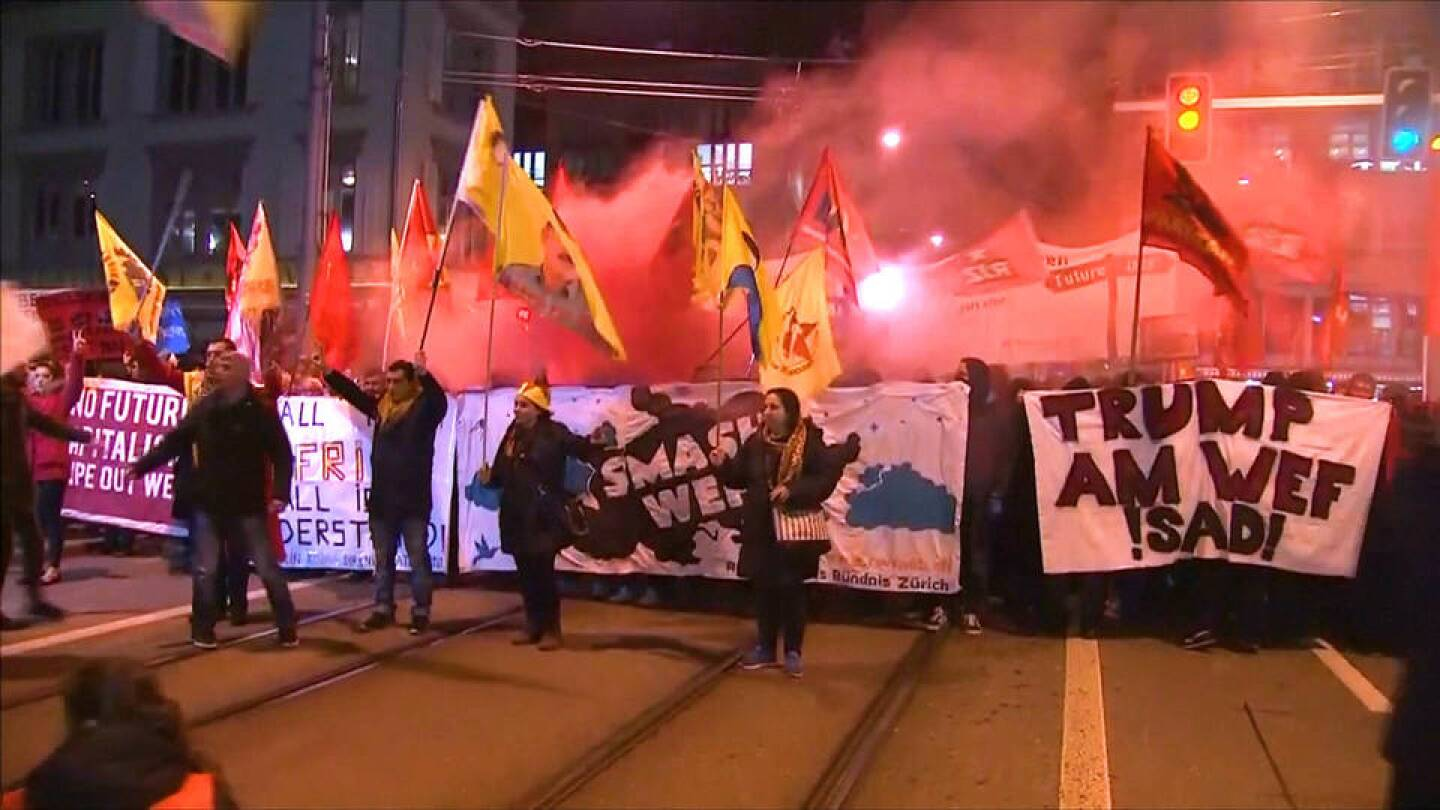 Protesters on the streets of Zurich ahead of the World Economic Forum. | Democracy Now