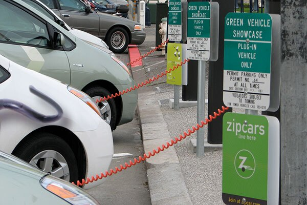 Three converted Prius Plug-In Hybrids charging at San Francisco City Hall public recharging station.   Felix Kramer / Creative Commons