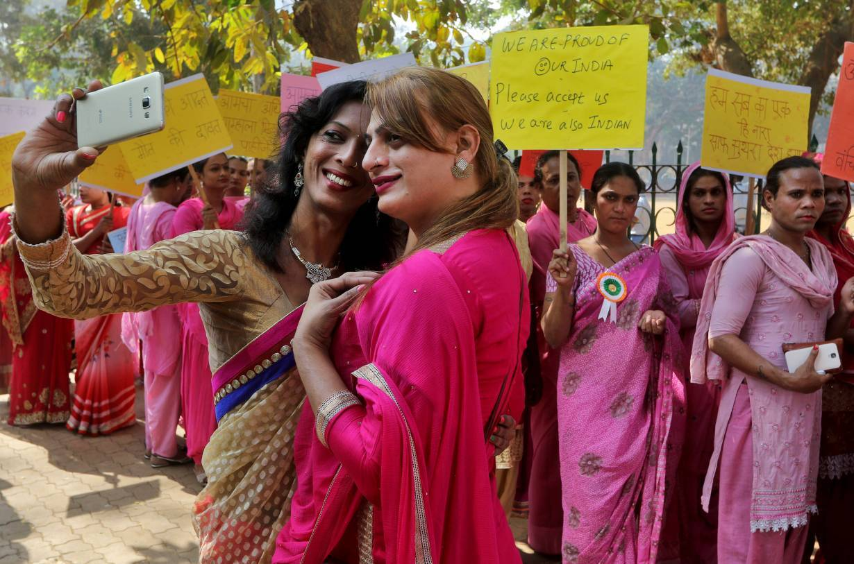 People belonging to the transgender community take a picture wearing saris with a mobile phone before the start of a rally for transgender rights in Mumbai, India, January 13, 2017.   REUTERS/Shailesh Andrade