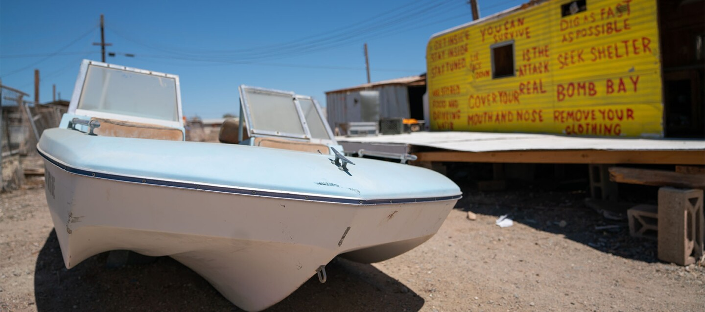 An abandoned speedboat and trailer at the Salton Sea | Katie Noonan