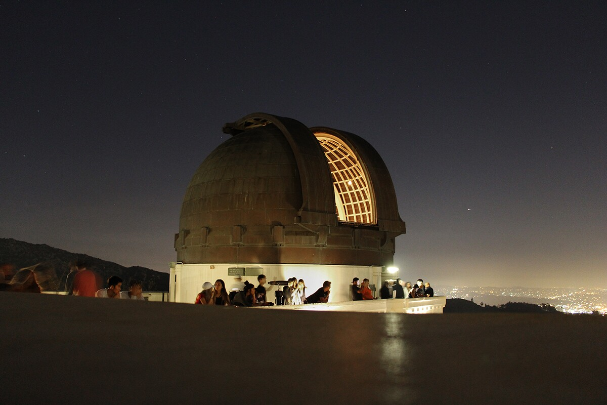 Exterior of Griffith Observatory's telescope at night. | Wikimedia Commons/ Dancorona21/Creative Commons (CC BY-SA 4.0)