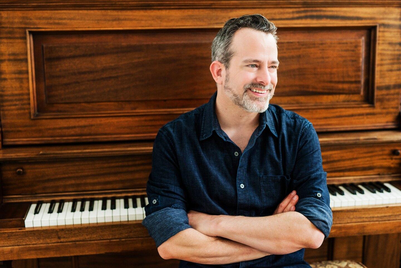 Composer Geoff Zanelli at the piano