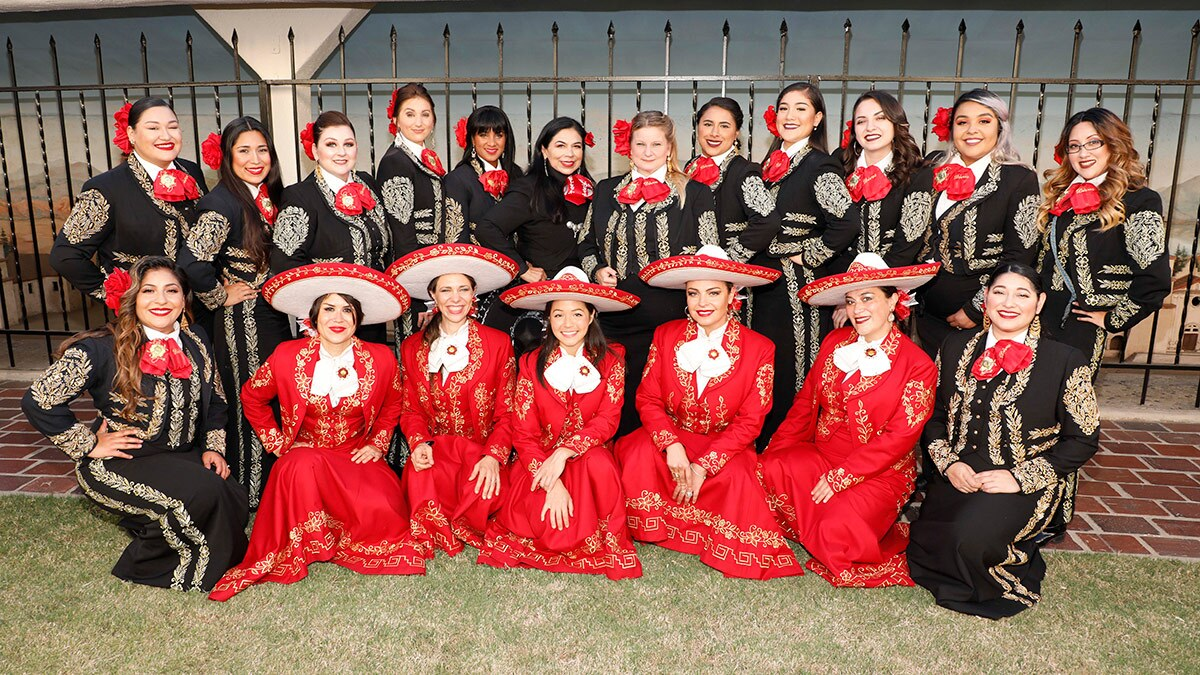 Mariachi Divas de Cindy Shea (top row), Leonor Xochitl Perez, Ph.D. (top row, sixth, clockwise) and Las Adelitas (bottom row, in red) from London at the International Mariachi Women's Festival, July 21, 2018. | Eddie Sakaki Photographer