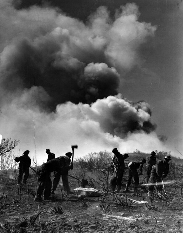 Firefighters battle a 1935 wildfire in Malibu's Corral Canyon. Courtesy of the Herald-Examiner Collection, Los Angeles Public Library.