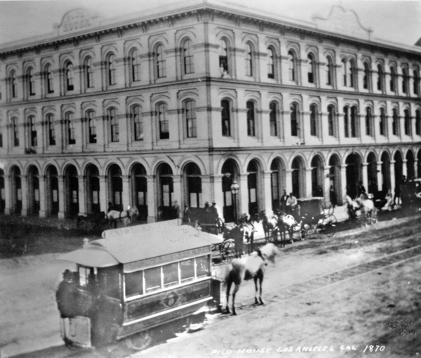 A horse-drawn streetcar of the Spring & Sixth railway in front of the Pico House. Courtesy of the Title Insurance and Trust, and C.C. Pierce Photography Collection, USC Libraries.