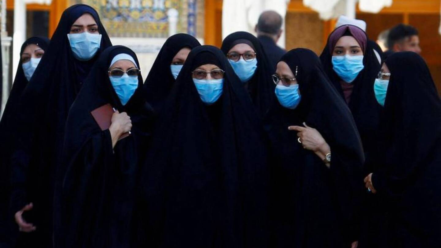Shi'ite Muslim women wear protective face masks at Imam Ali Shrine, following an outbreak of coronavirus, in the holy city of Najaf, Iraq March 11, 2020. | REUTERS/Alaa al-Marjani