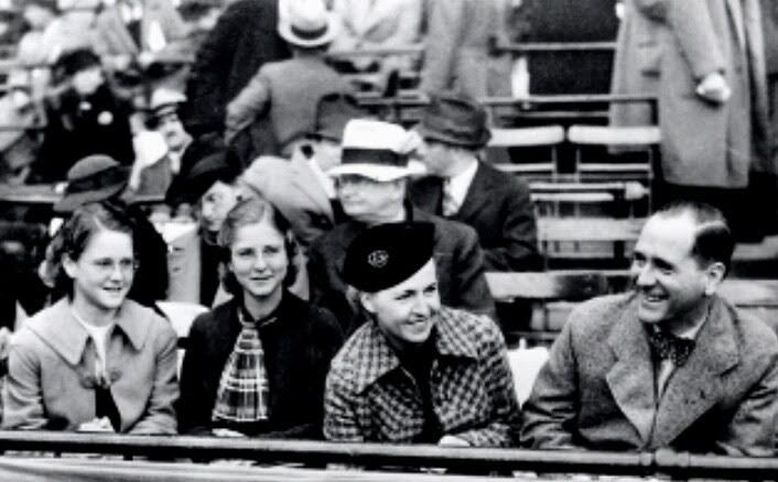 Harry Bennett sits alongside family members Aunt Trudy, his daughter Billie and his wife Esther at a race event.
