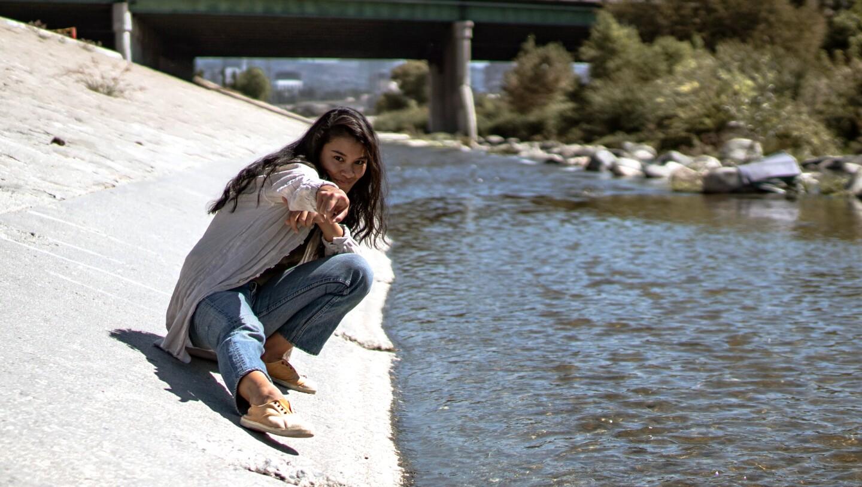 KCET host Rosey Alvero along the LA River.