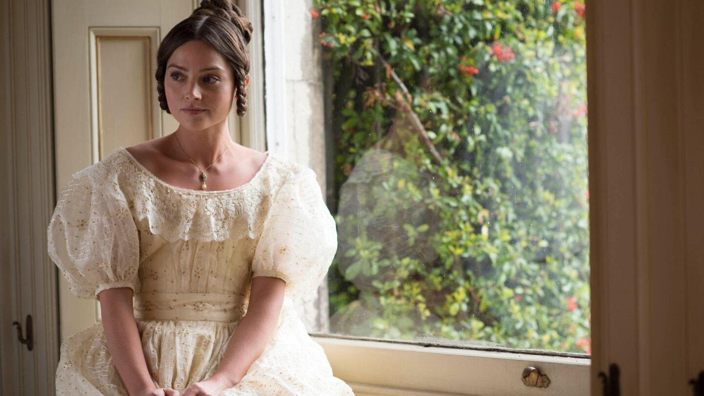 "Jenna Coleman as young Queen Victoria sits by a window. | From ""Victoria on Masterpiece: Episode 1"""