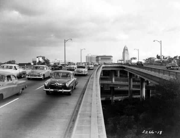 Automobiles on the Hollywood Freeway crossing the top level of the interchange in 1953. Courtesy of Caltrans.