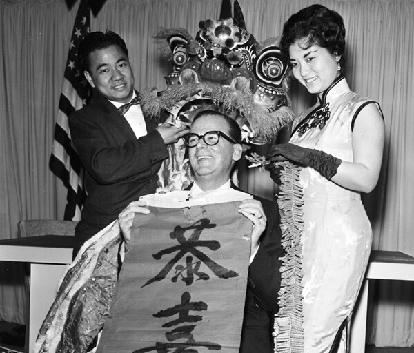 Chinese New Years, 17 February 1961. Bill Hong; Mayor Norris Poulson; Julie Li. Courtesy of USC Libraries