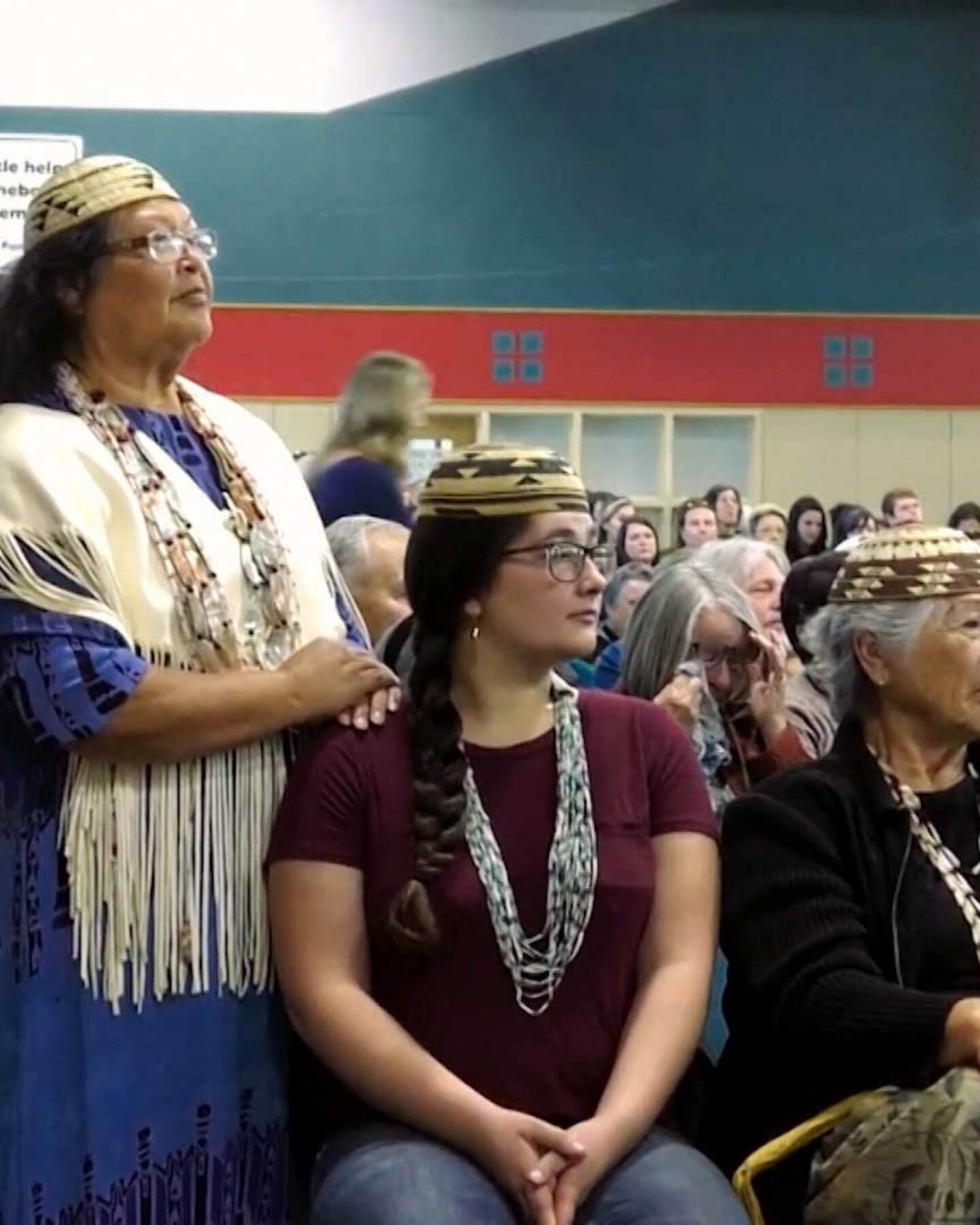 """Cheryl Seidner and other members of the Wiyot tribe at a hearing for Terra-Gen's wind farm proposal. 