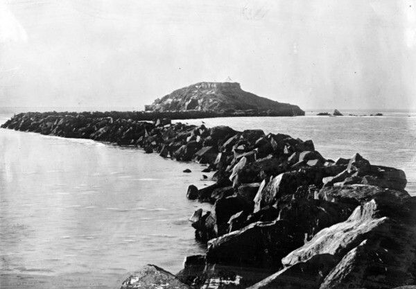 A jetty extended between Dead Man's Island, seen here in 1870, and nearby Rattlesnake Island, creating a narrow channel between the islands and the mainland. Courtesy of the USC Libraries - California Historical Society Collection.