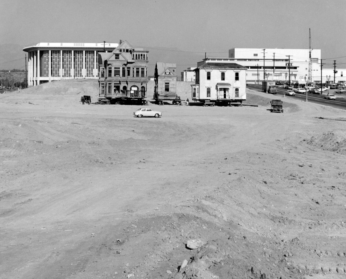 Two remnants of Bunker Hill, their surroundings completly transformed by regrading, prepare for relocation. Courtesy of the Security Pacific National Bank Collection - Los Angeles Public Library.