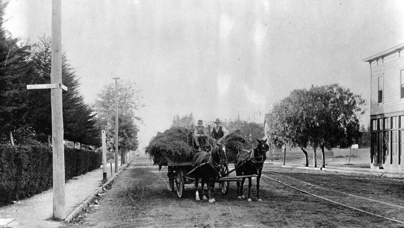 A horse-drawn wagon, seen here at Pico and Figueroa circa 1890, transports hay from the countryside into the city. Courtesy of the Security-Pacific National Bank Collection - Los Angeles Public Library.