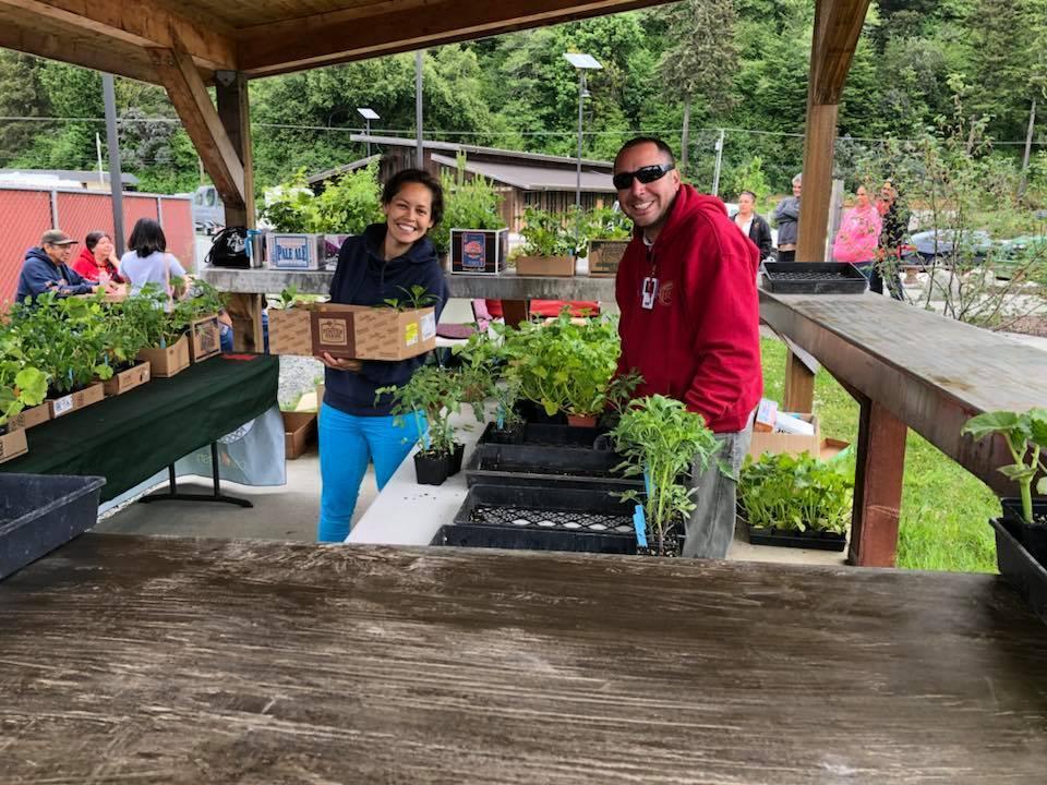 Potawot Community Food Garden staff sets up for farmers market. | Courtesy of Potawot Community Food Garden's Facebook page