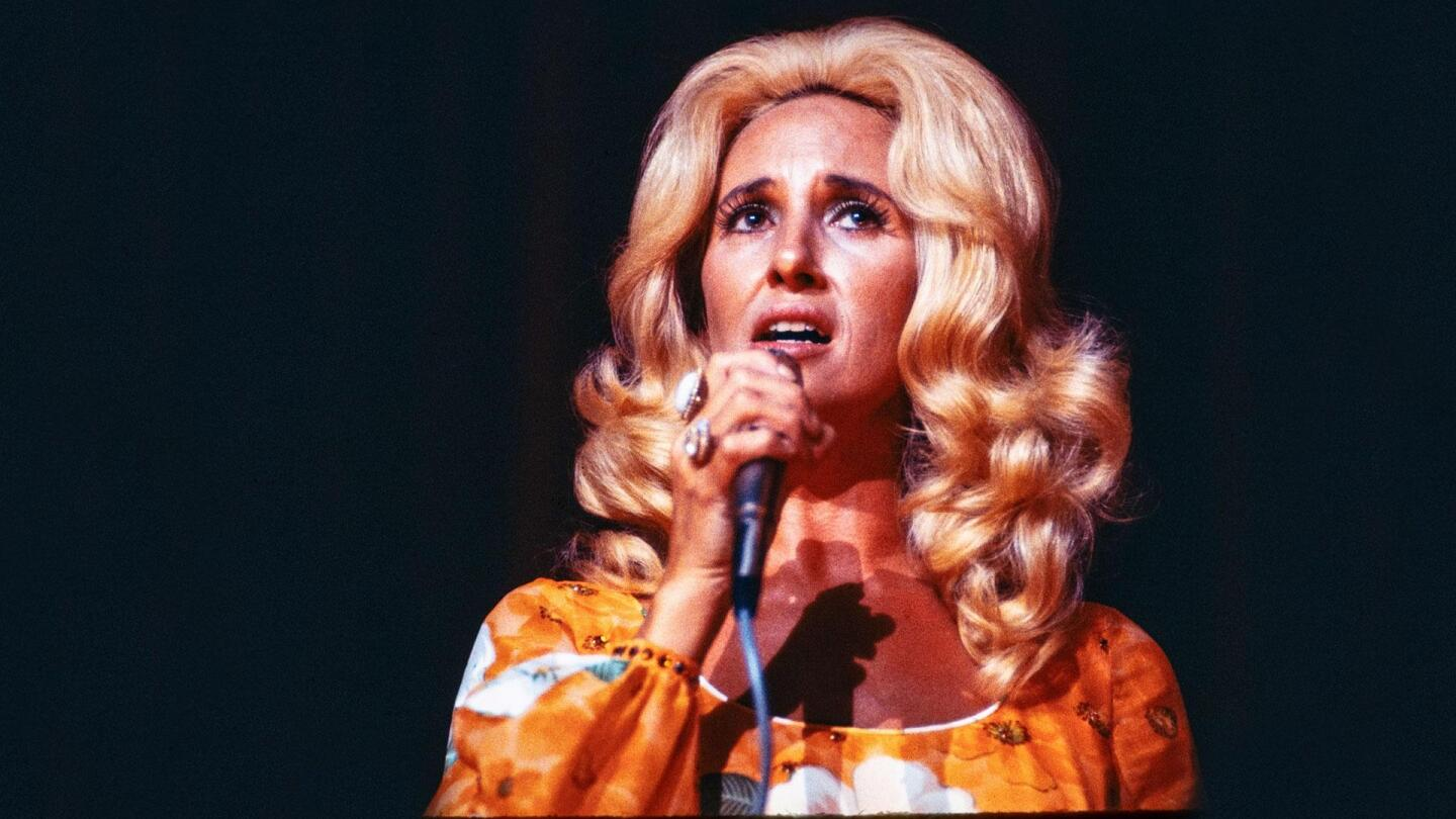 "A woman sings into a microphone. | From ""Country Music: Are You Sure Hank Done It This Way? (1973-1983)"""