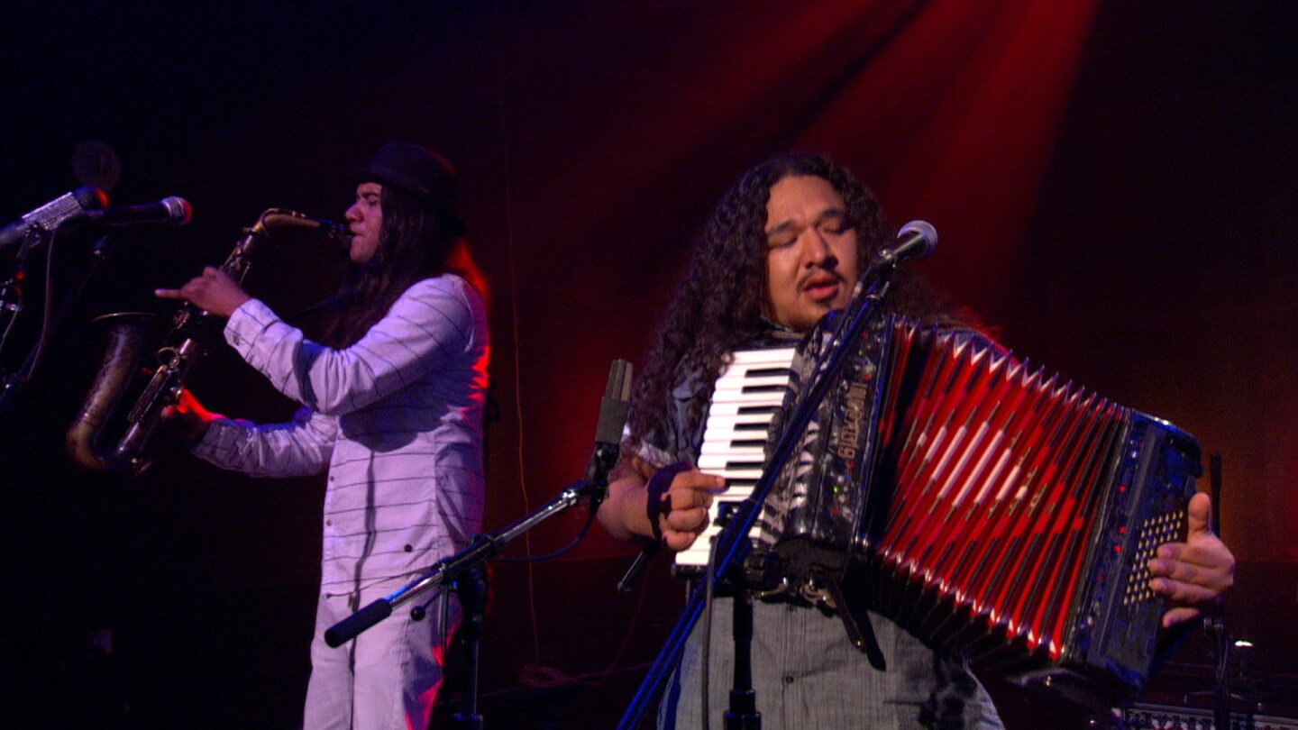 Members of Buyepongo Play Accordion and Saxophone