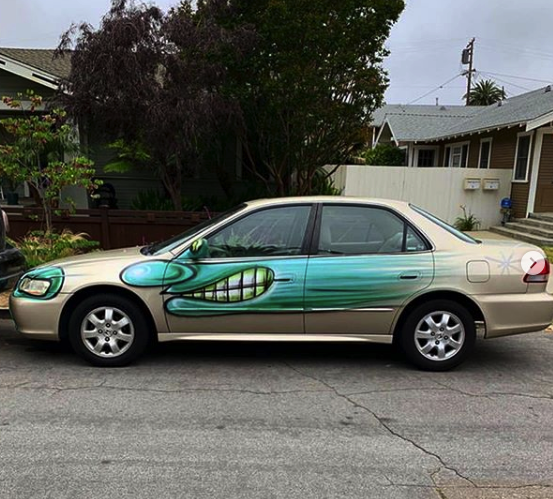 "A beige sedan bombed by Kenny Scharf for his ""Karbombz!"" project 