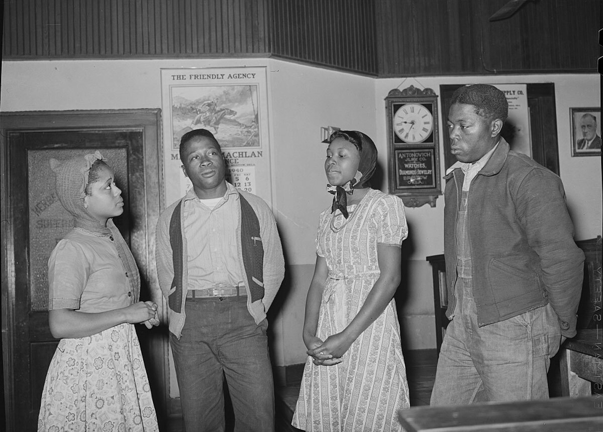 Young men and women humming spiritual at UCPAPWA (United Cannery, Agricultural, Packing, and Allied Workers of America) meeting, Bristow, Oklahoma. | Courtesy of the Library of Congress