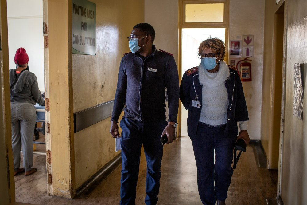 The only two Nurses on duty, Sipho Wilson Batlhaping (29) and Ruth Seikaneng (64) walk through a corridor of the Reivilo Health Centre in Reivilo on Sept. 3, 2020. | Thomson Reuters Foundation/Gulshan Khan