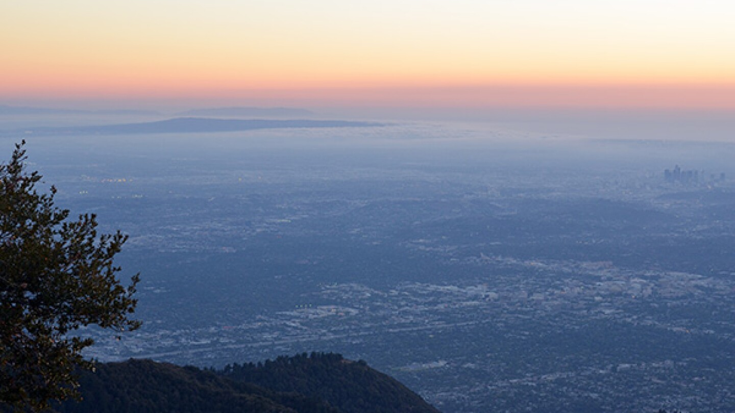 The view from atop Mount Wilson. Catalina Island can be seen top left, and the downtown Los Angeles skyline is visible far right. The entire city of Pasadena is visible in the lower half of the picture. | Photo: Elson Trinidad