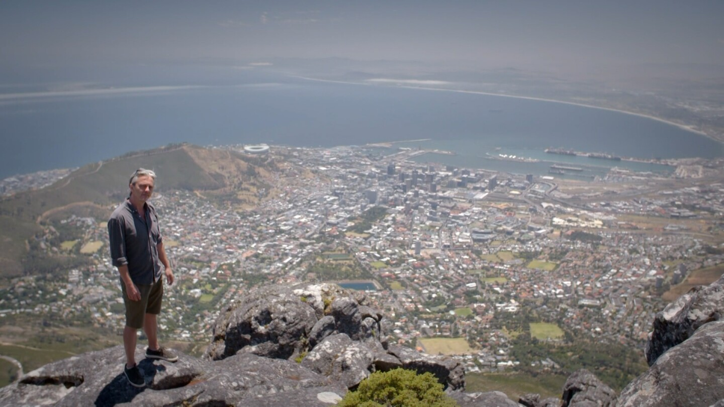 """""""Life-Sized City"""" host Mikael Colville-Andersen stands at the edge of a cliff overlooking Cape Town, South Africa. 