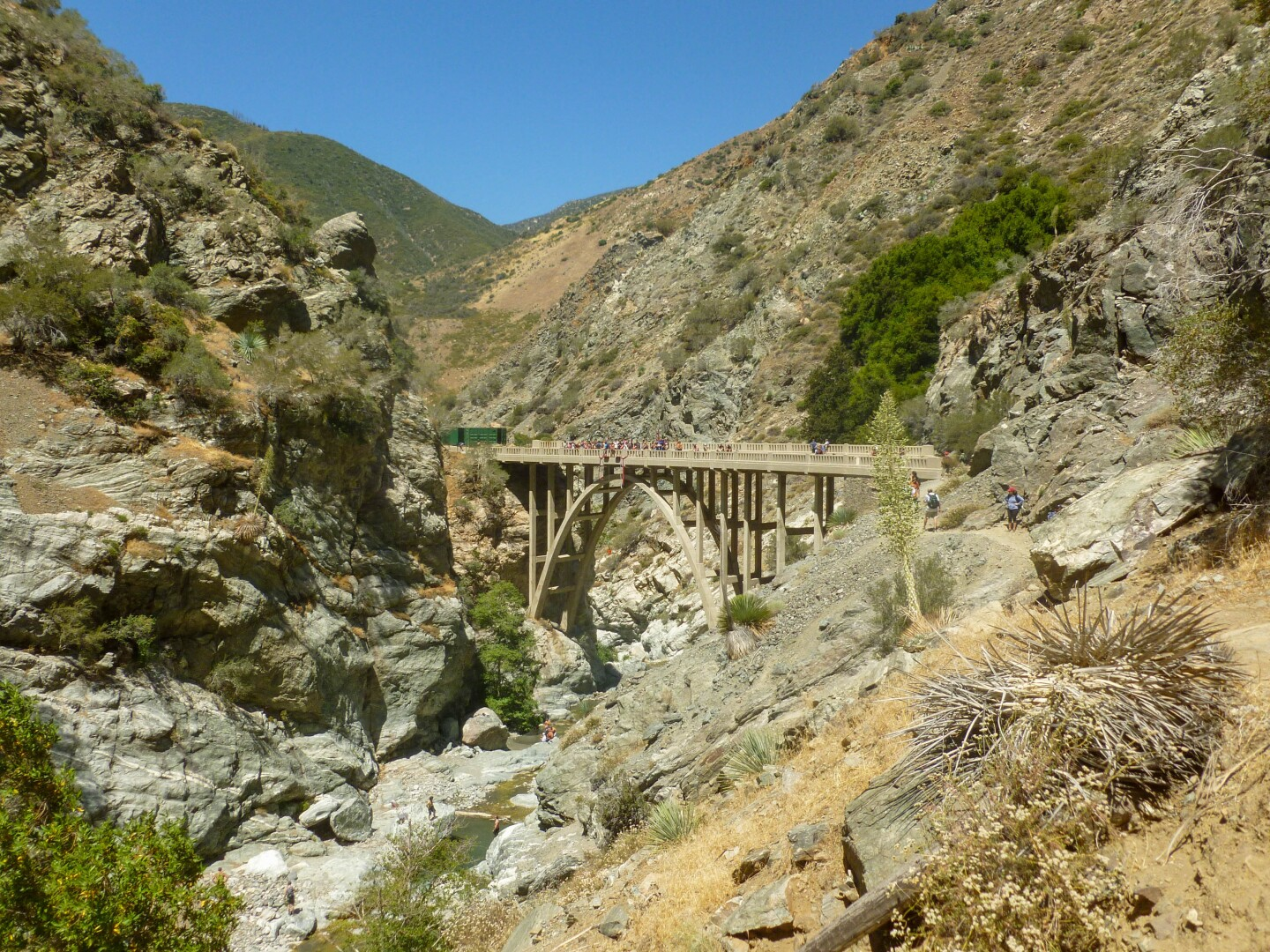 The abandoned bridge at the end of theBridge to Nowhere hike in the San Gabriels'Sheep Mountain Wilderness Area. The bridge is a jumping point for bungee jumpers while a refreshing creek is available for hikers to cool off below.
