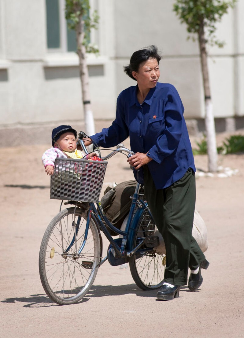 Mother and child in front of the Tumangang train station in North Korea   Mark Edward Harris/Getty Images