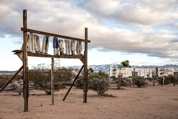 "Noah Purifoy, ""From the Point of View of the Little People,"" 1994. Mixed media construction. 120 x 96 x 18 in. Noah Purifoy Foundation."