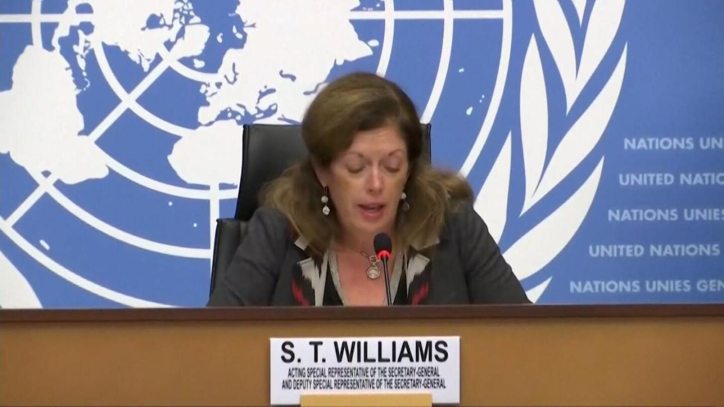 Stephanie T. Williams speaks into a microphone to announce Libyan ceasefire.