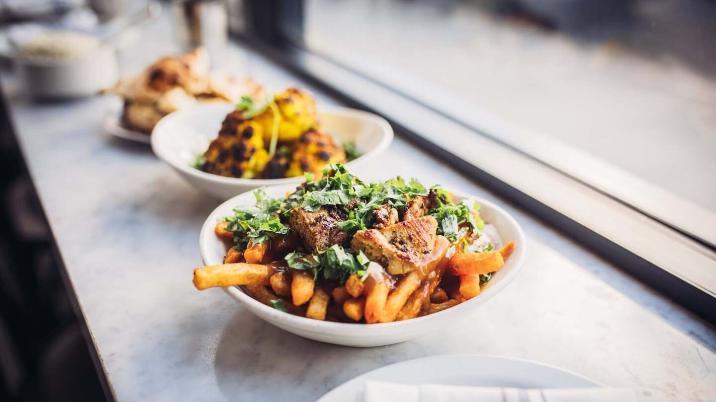Chicken Tikka Poutine | Courtesy of Life & Thyme