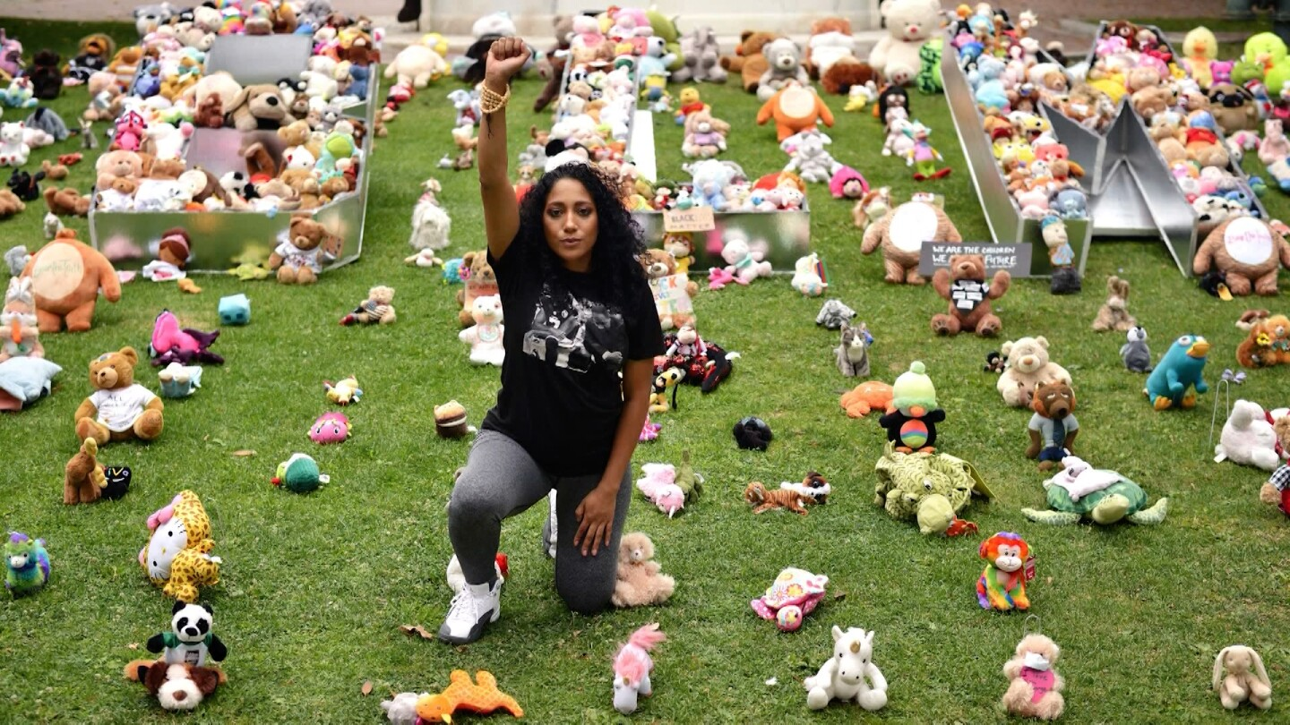 Woman with raised fist amid teddy bears | Still from Southland Sessions S1 E1 Change(Makers)