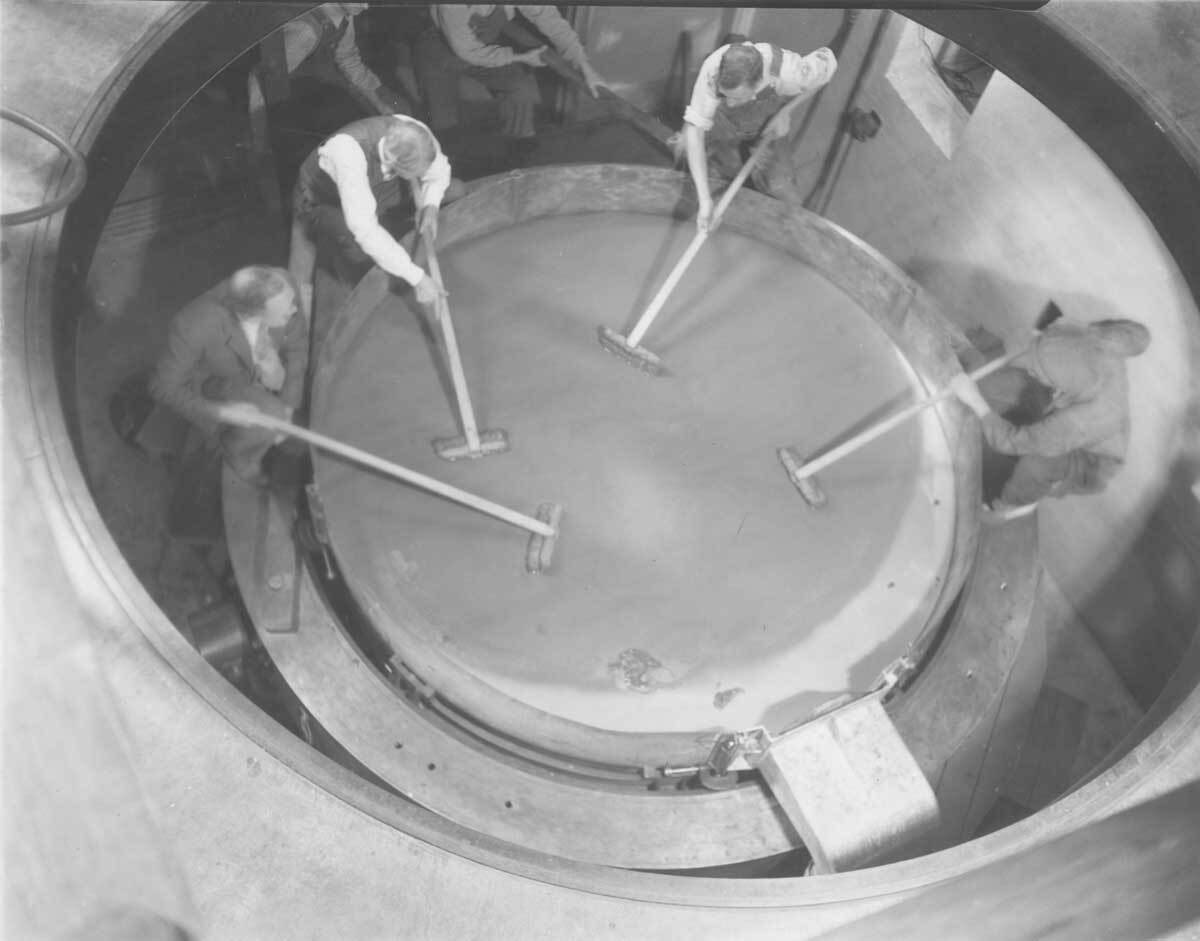 Cleaning the mirror for the Hooker 100-inch telescope at Mount Wilson Observatory  |  Image courtesy of the Observatories of the Carnegie Institution for Science Collection at the Huntington Library, San Marino, California