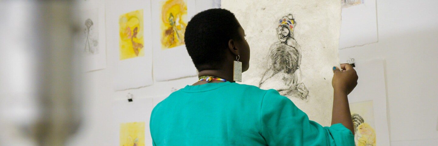 "Kenyatta A.C. Hinkle at work | Still from KCET Artbound's ""Artist and Mother"" Mother AB s9"