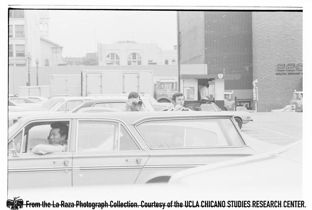 CSRC_LaRaza_B15F5C1_Staff_003 Man photographs protesters against Rodino Bill | Raul Ruiz, La Raza photograph collection. Courtesy of UCLA Chicano Studies Research Center