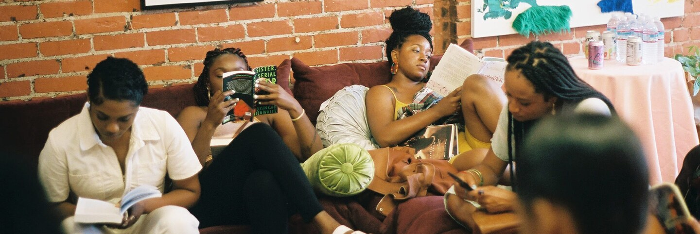 People read at the Reparations Club. | Cara Elise Taylor
