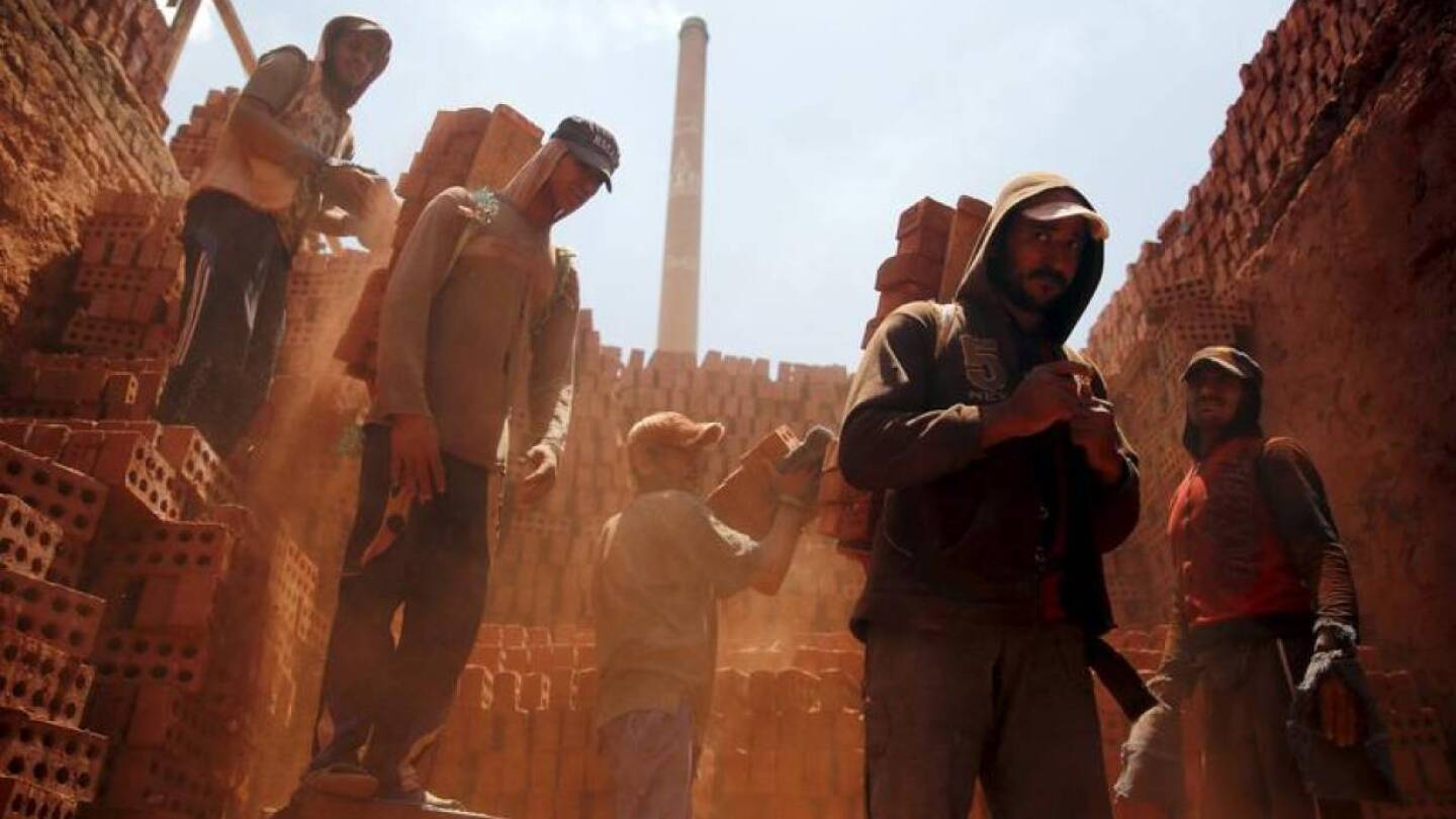 Laborers work at a traditional bricks factory in Arab Mesad district of Helwan, northeast of Cairo, May 14, 2015.