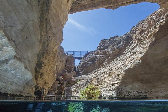 A view of Devils Hole from within the pool. The public overlook can be seen in the distance. | Photo: Brett Seymour (NPS) 2015.
