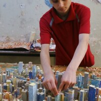 Mohammed Qutaish works on a paper model of the city of Aleppo | Baraa Al-Halabi/AFP/Getty Images